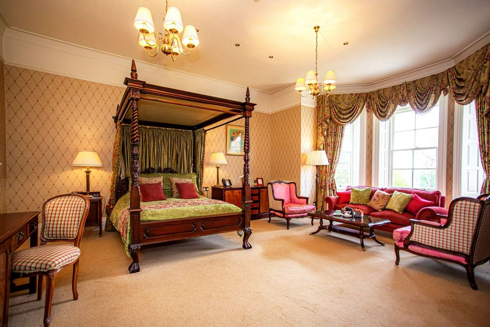 View of bed and seating are in feature room at Judges Hotel